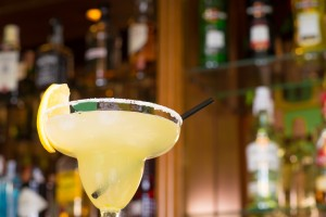 Margarita glass against the background of bar shelves