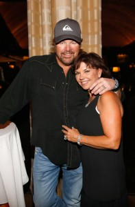 LAS VEGAS, NV - AUGUST 18:  Recording artist Toby Keith (L) and SwingDish creator and designer Tricia Covel attend the SwingDish Launch Event at The Country Club at Wynn Las Vegas on August 18, 2015 in Las Vegas, Nevada.  (Photo by Isaac Brekken/Getty Images for Swingdish)